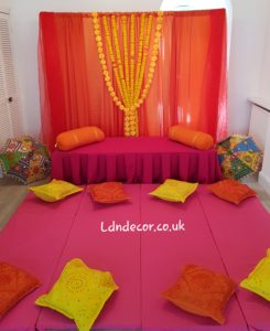 Orange and Yellow garlands Mehndi backdrop