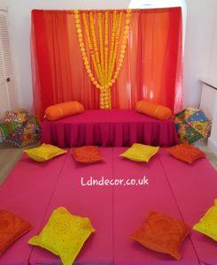 Orange and Yellow garlands Mehndi backdrop