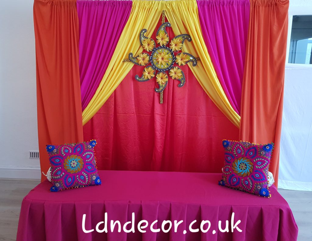 Red, Orange, Yellow, Pink backdrop with rangoli centrepiece price