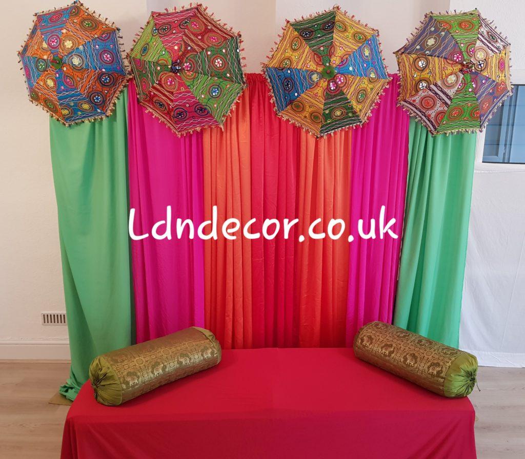 Green. Pink. Orange & Red mehndi backdrop with umbrellas