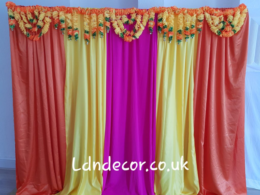 Colourful mehndi backdrop with garland london