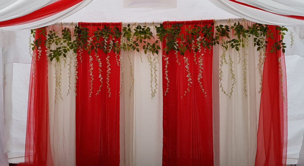 Red & White backdrop with Foliage
